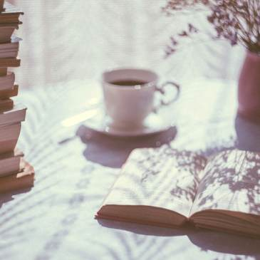 book-stack-cup-coffee-cafe-vase-flowers-sunshine-