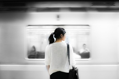 Woman in subway train standing