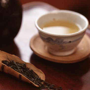Korean tea in white cup on wooden table
