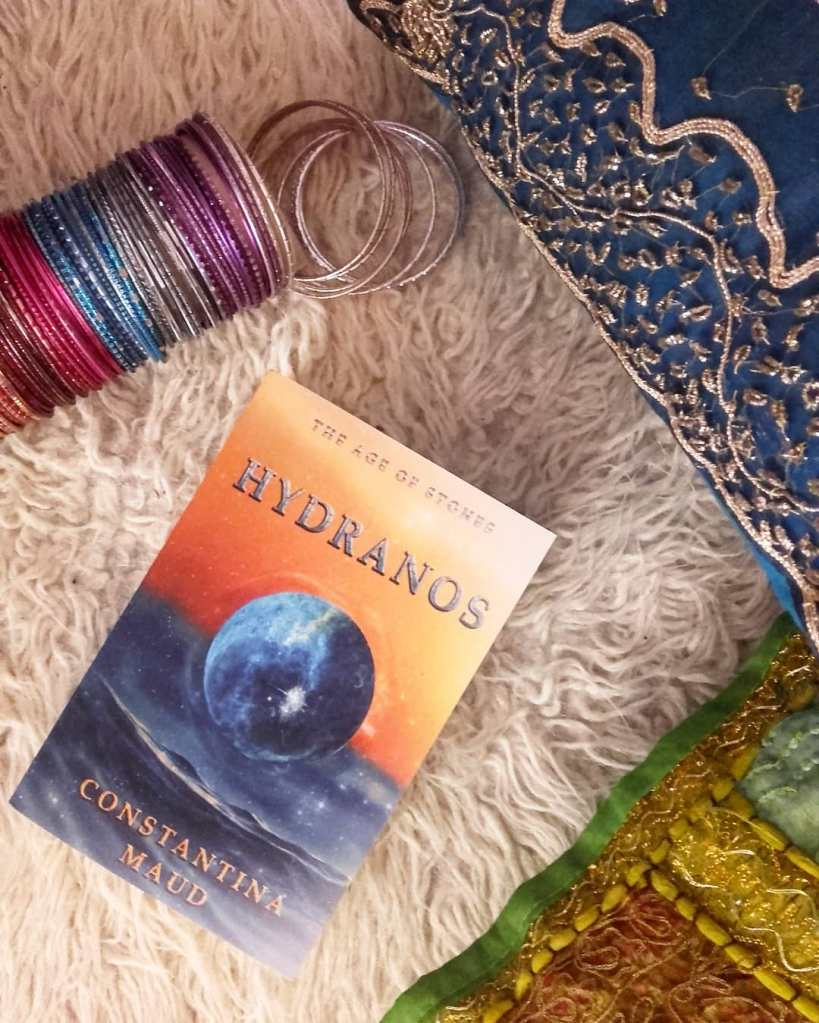 Hydranos fantasy book with boho Indian cushions and colorful bangles
